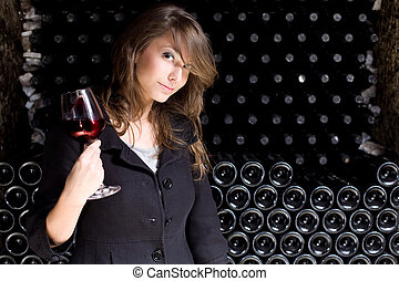 Beautiful young woman tasting wine. - Portrait of a...
