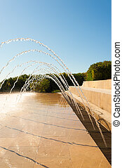 Fountain - Simple arched fountain in a beautiful park...