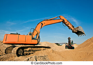 Excavators at a Sand Quarry - Excavator Digging Sand at a...