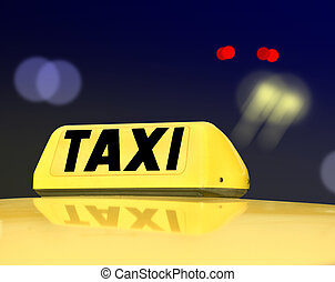 Taxi sign at night traffic