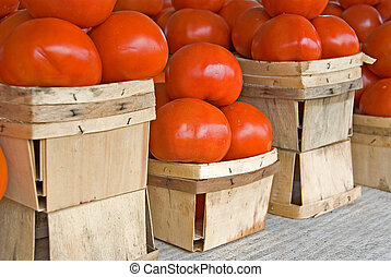 Homegrown tomatoes - Ripe tomatoes in produce boxes at the...