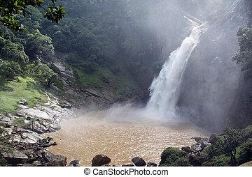 Waterfall and pool with brown water in Badulla, Sri Lanka