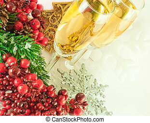 Christmas champagne and branch of berries with a fur-tree