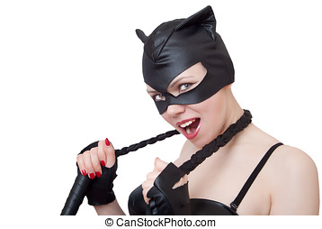 Young woman in an erotic suit of a cat, a wild look holding...