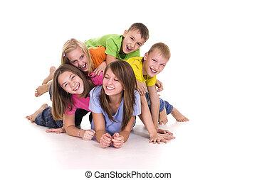 cute kids on white - portrait of a five happy kids posing on...