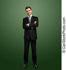 full length male in suit with folded hands - full length...