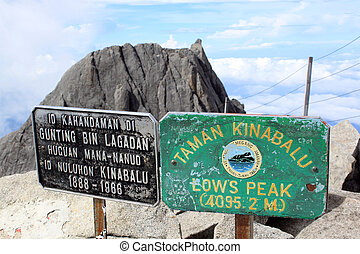 Signs on the summit of mount Kinabalu in Sabah, Borneo,...