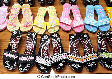 Sandals in the shop as a souvenie for tourist in Vietnam