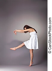 young woman dance with shadow