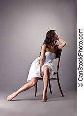 Perfect dancer in white cloth sit on chair