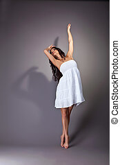 Perfect young dancer in white cloth