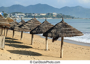 Umbrellas on the sand beach in Nha Trang, Vietnam