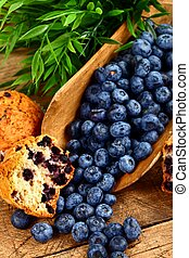 Muffins and fruits - Blueberry muffins with fruits on rustic...
