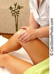 Massage therapy - Woman receiving foot massage in a salon