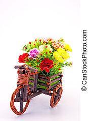 beautiful and colorful flower bouquet in wooden basket in...