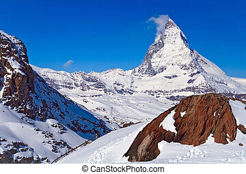 Landscape of Matterhorn peak with Red rock located at Gornergrat in Switzerland