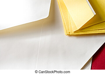 A pile of envelopes on the red background