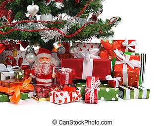 Christmas gifts - heap of festive gift boxes under decorated...