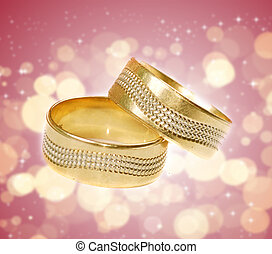Wedding rings in abstract background