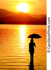 silhouette of young woman against summer sunset - silhouette...