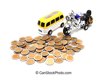 Motorcycle and van  over a lot of golden coins (isolated on whit