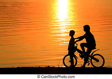 Boy and girl on BMX silhouette background