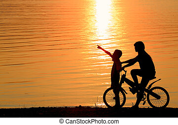 Boy and girl on BMX silhouette background. - Boy and girl on...