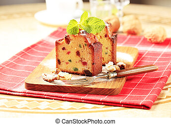Slices of fruitcake garnished with mint sprig