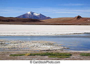 Mount and salt lake near Uyuni in Bolivia