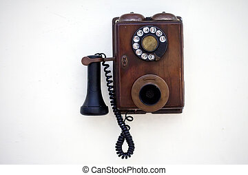 Retro phone on a white wall
