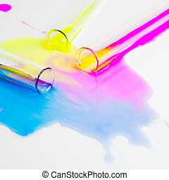 test tubes with colorful substances spilled on a white table...