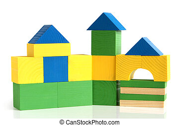 House made from children's wooden building blocks on a white...