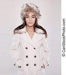 winter woman - brunette woman wearing winter coat and hat