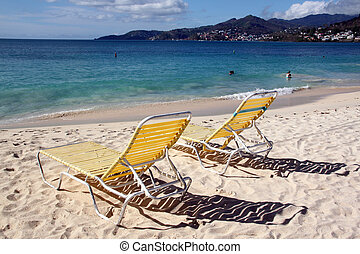 Chairs - Yellow chairs on the wite sand beach Grand Amse in...