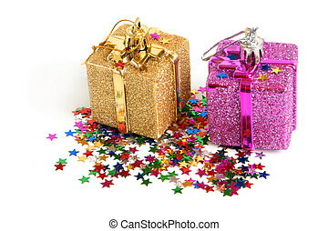 Two christmas toys with confetti on a white background