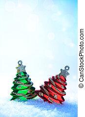 two Christmas tree on white snow