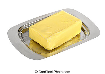 Butter on silver butter dish isolated on white background