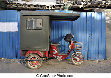 Ricksha in Beijing - Ricksha parked in a hutong in Beijing,...
