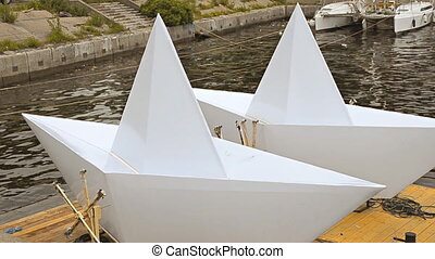Large Scale Paper Boat Models on the river
