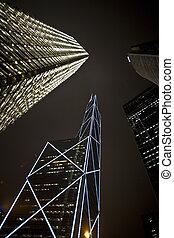 facade of skyscrapers by night - facade of skyscrapers...