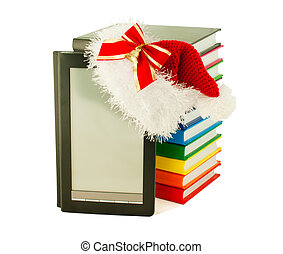 Electronic book reader wearing Santas hat with stack of...