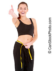Fitness woman with measure tape