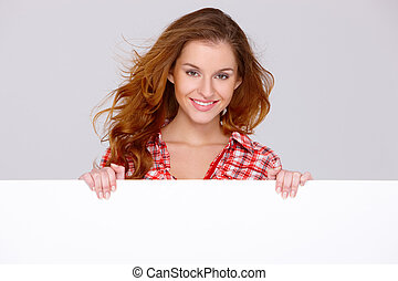 Young woman in casual clothing holding empty board - Lovely...