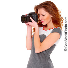 Woman in gray dress wit digital camera on white - Cute young...