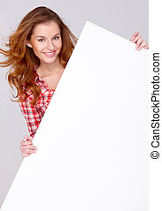Young woman in casual clothing holding empty board