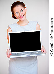 Young attractive business woman with laptop computer -...