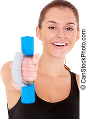 Portrait of fitness woman working out with free weights on...