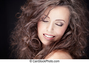 gorgeous brunette - close-up portrait of young smiling...