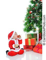 Cheerful boy in Santa Claus hat - Cheerful boy in christmas...