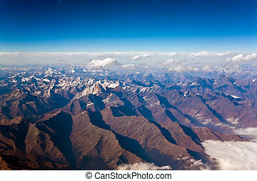beautiful view from the aircraft to the mountains of the...